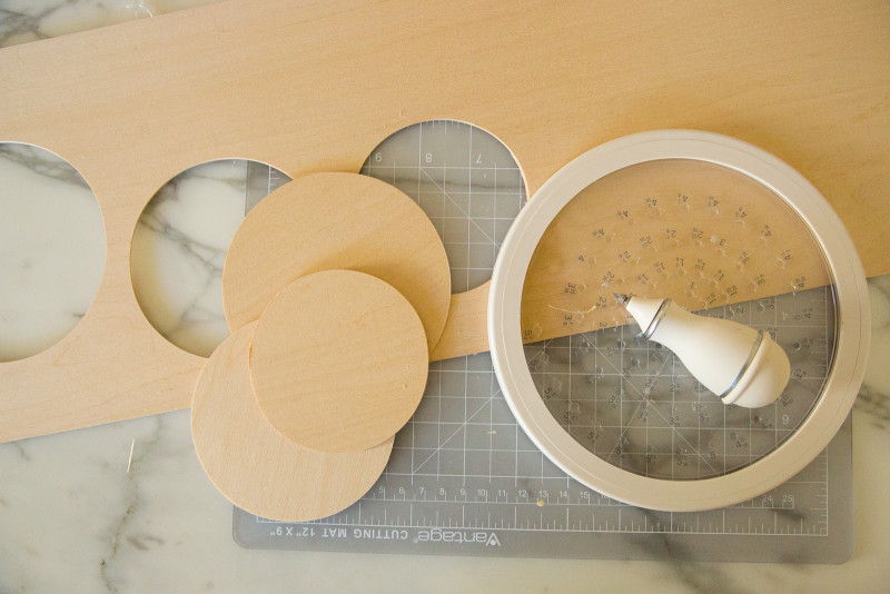 Wood circles cut out of a larger wood sheet with a circle cutter.