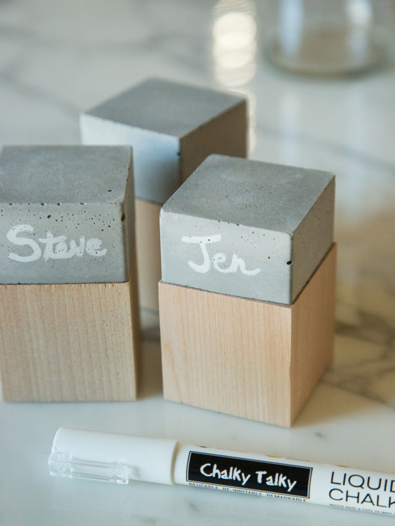 A close up of finished DIY cement and wood place cards.
