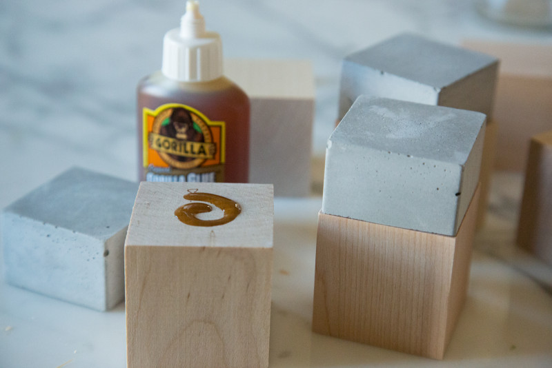 Cement cubes being glued to wooden cubes with Gorilla glue.