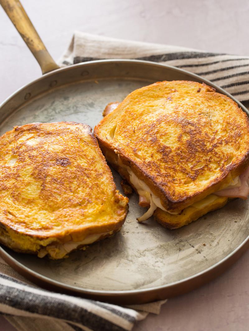 Monte Cristo sandwiches in a skillet.