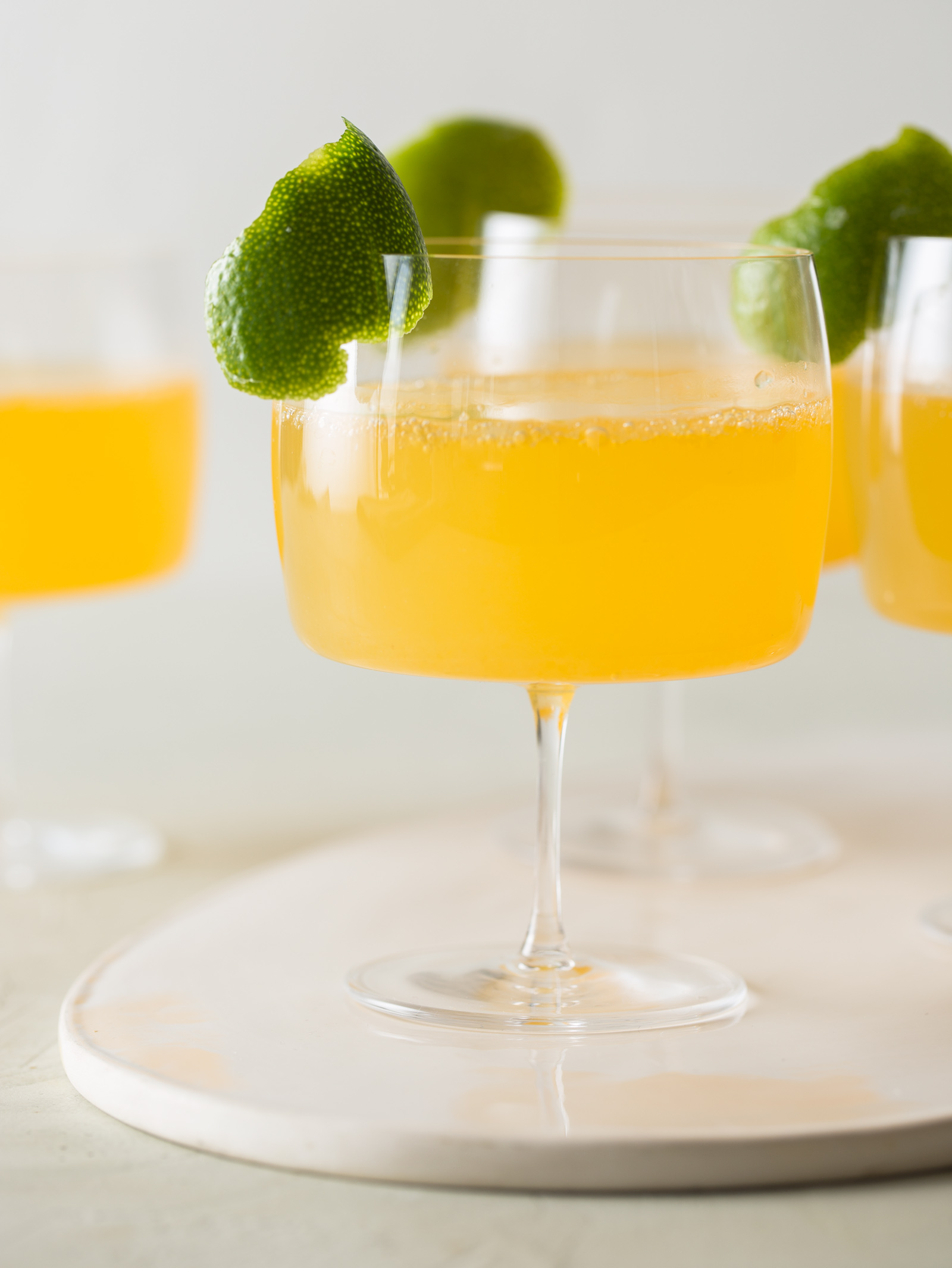 Citrus and Ginger Champagne Cocktail - Spoon Fork Bacon