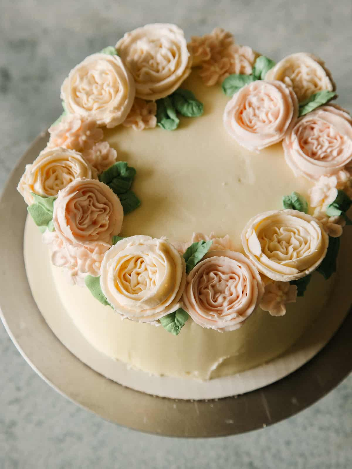 Floral wreath cake on a plate.
