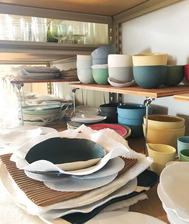 A close up of stacked bowls in different sizes and colors.