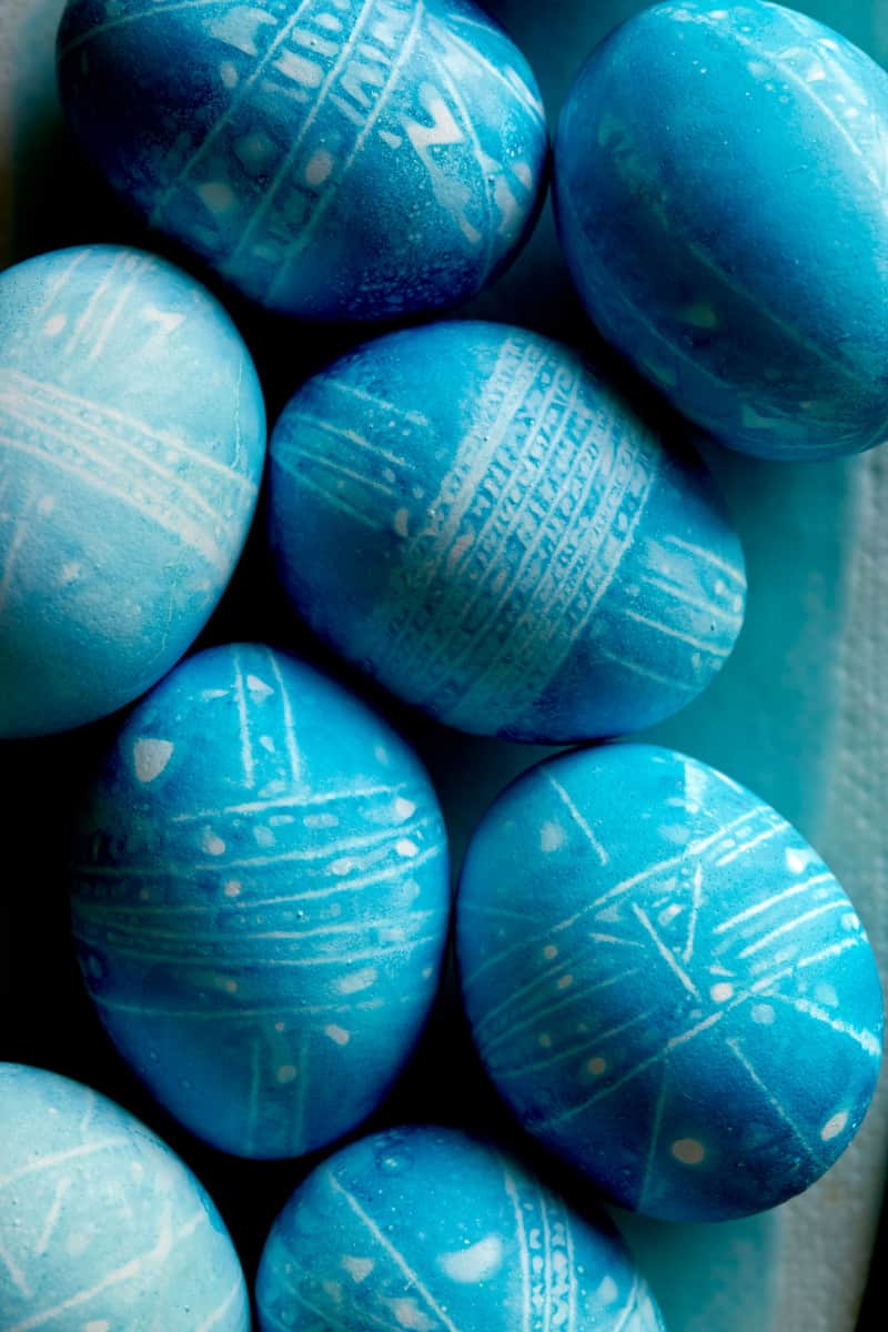 A detailed close up of Blue DIY shibori style easter eggs.