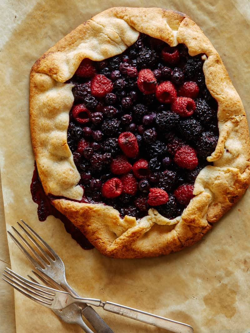 A mixed berry galette with forks.