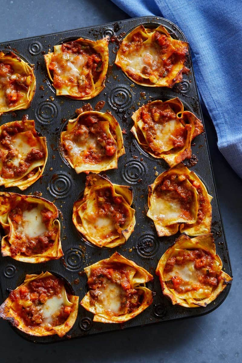 Baked off lasagna cups in a muffin tin.