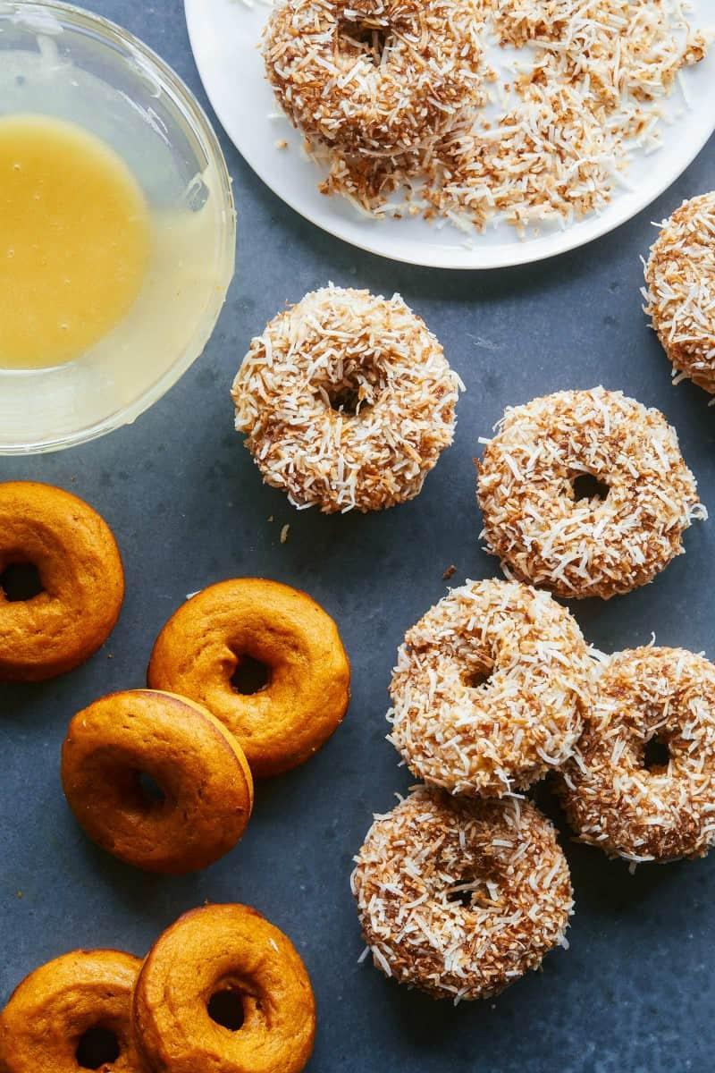 Baked pumpkin cake doughnuts with and without maple glaze and toasted coconut.