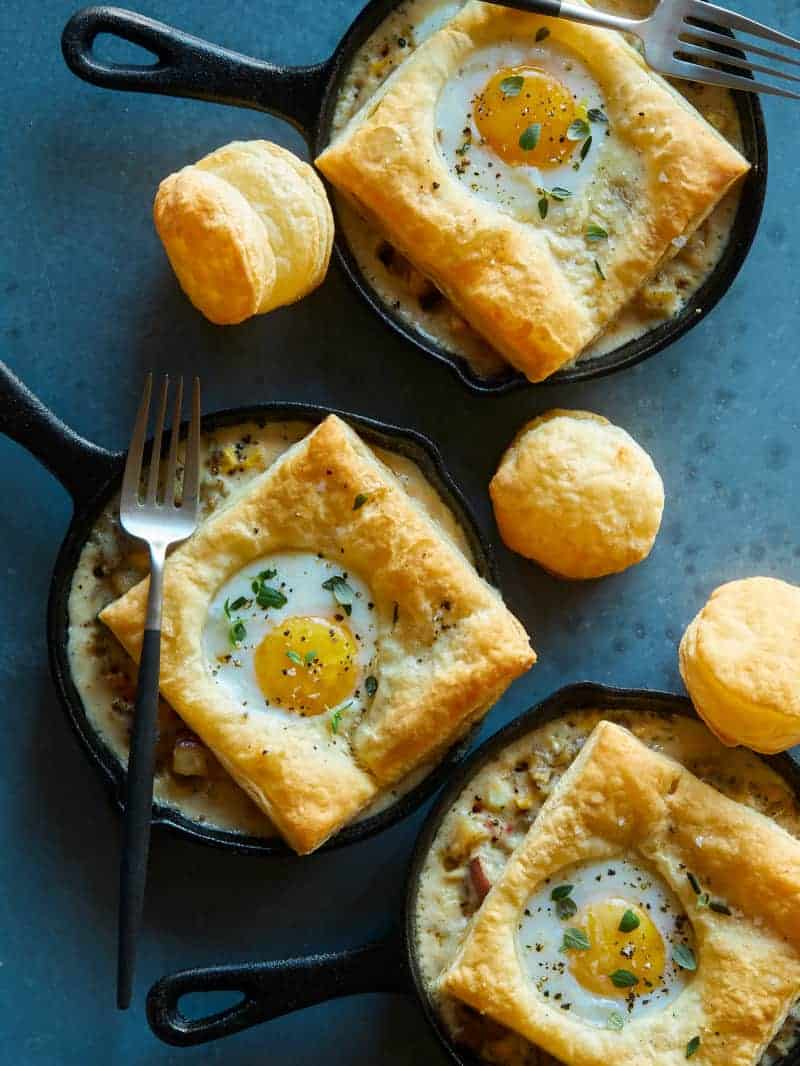 Individual breakfast pot pies with a fork.
