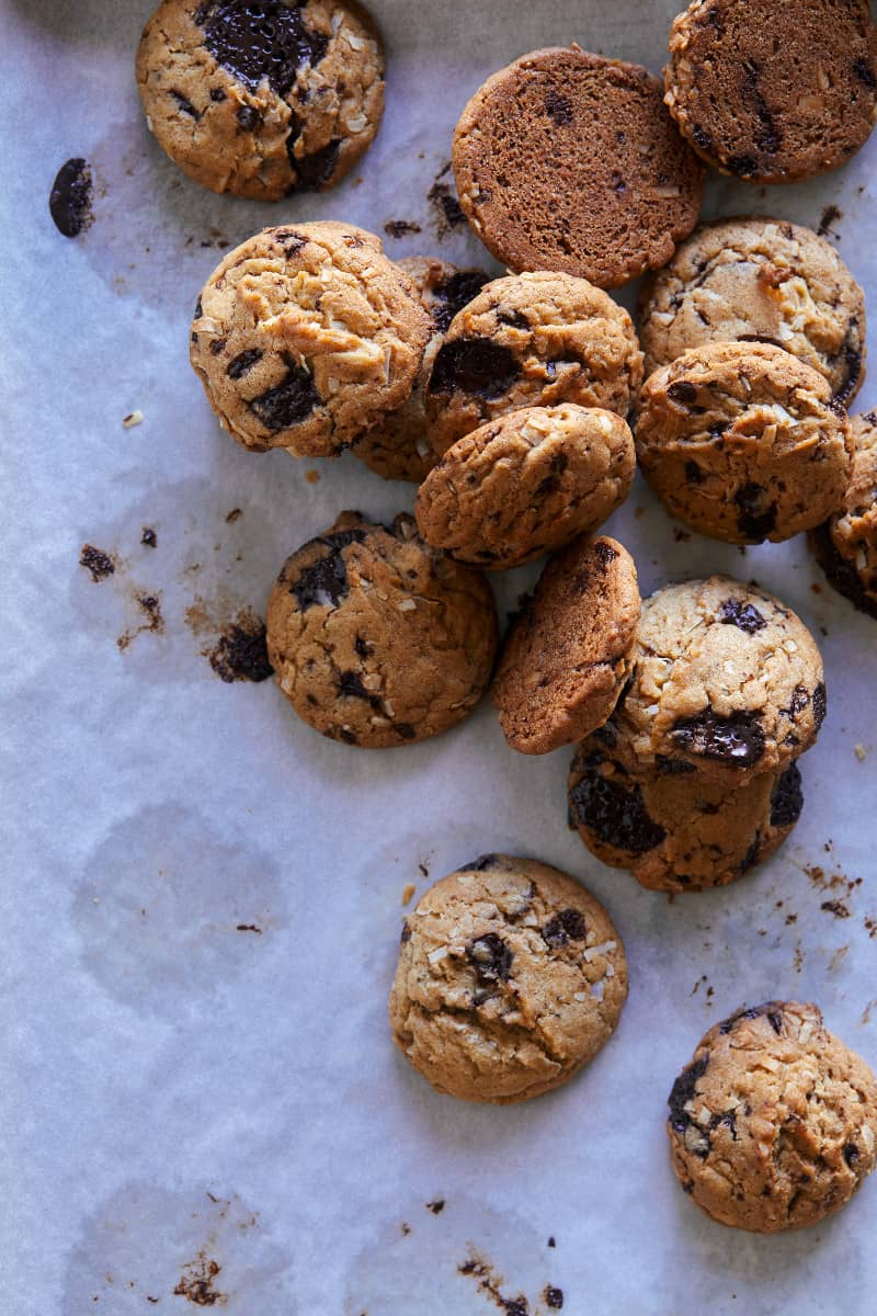 A close up of chai, chocolate chip, and coconut cookies.