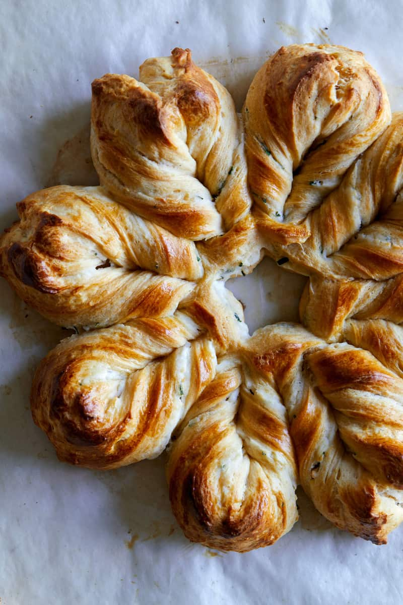 A close up of herb and cheese braided star bread.