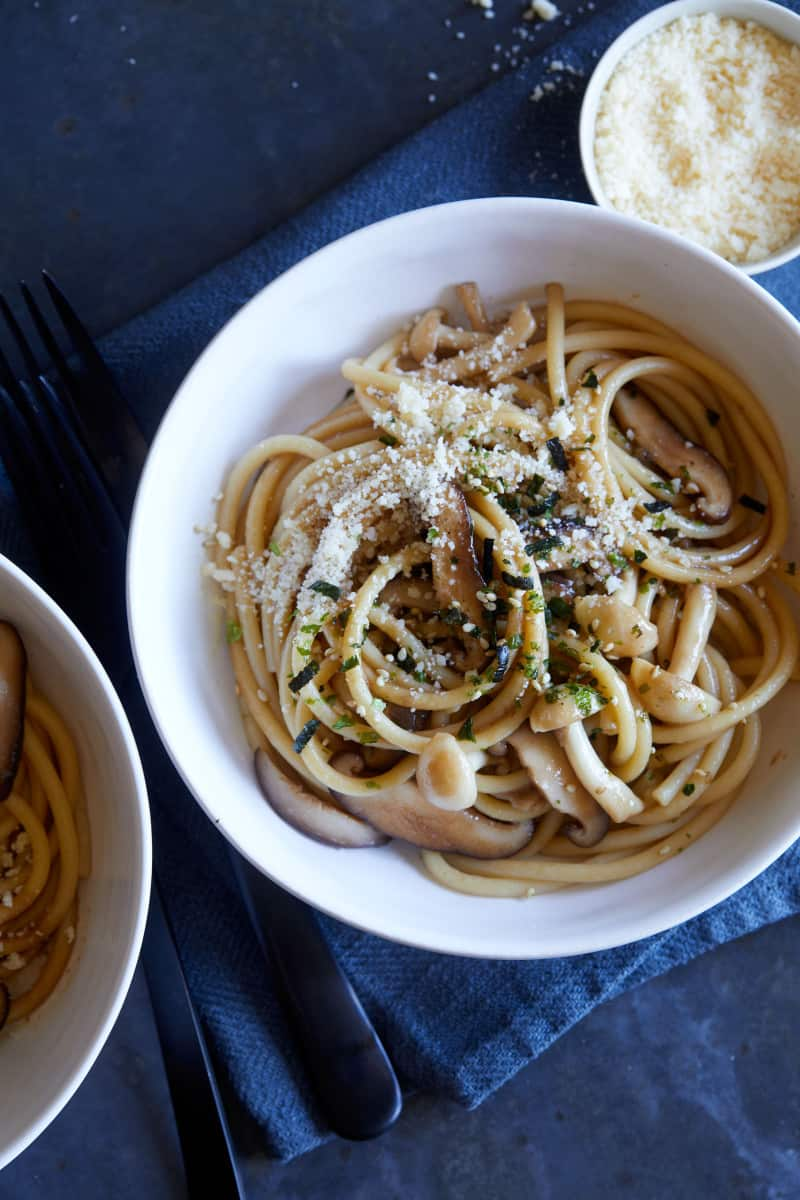 A close up of bowls of wild mushroom wafu pasta with soy butter sauce.