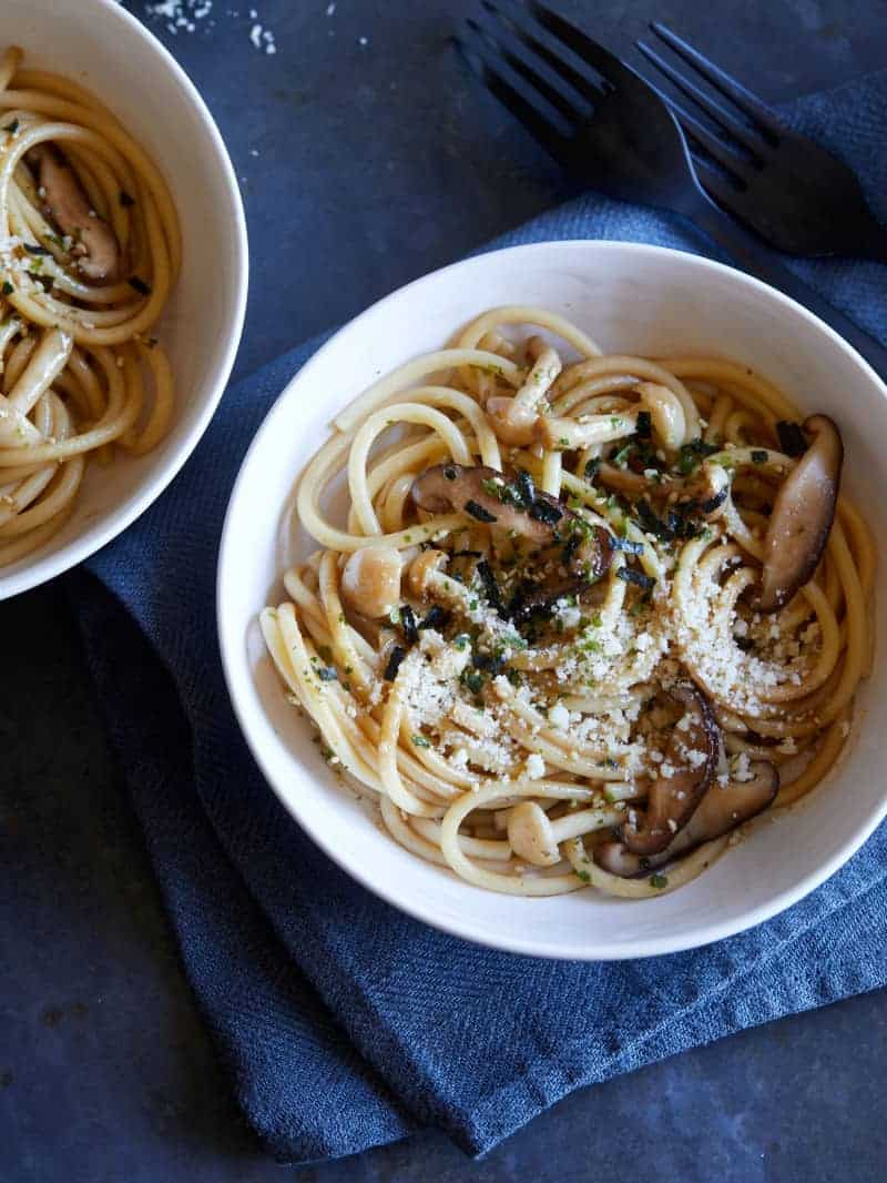 Bowls of wild mushroom wafu pasta with soy butter sauce.