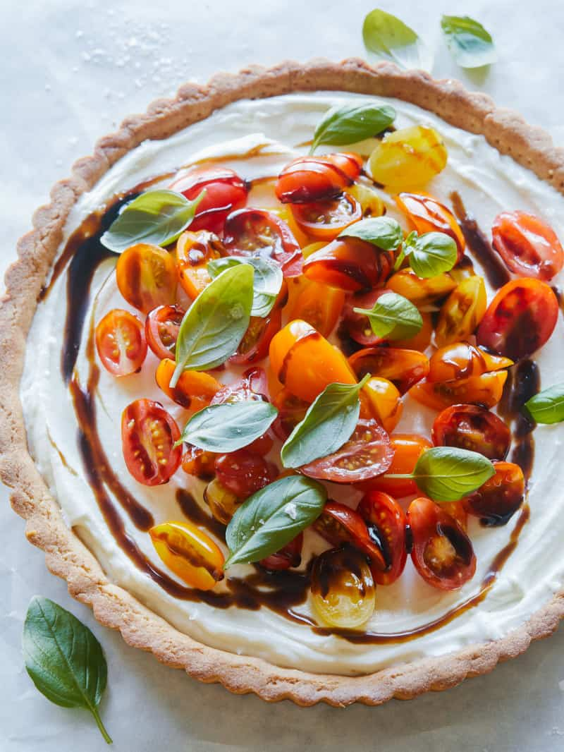 A whole bruschetta and whipped goat cheese tart.