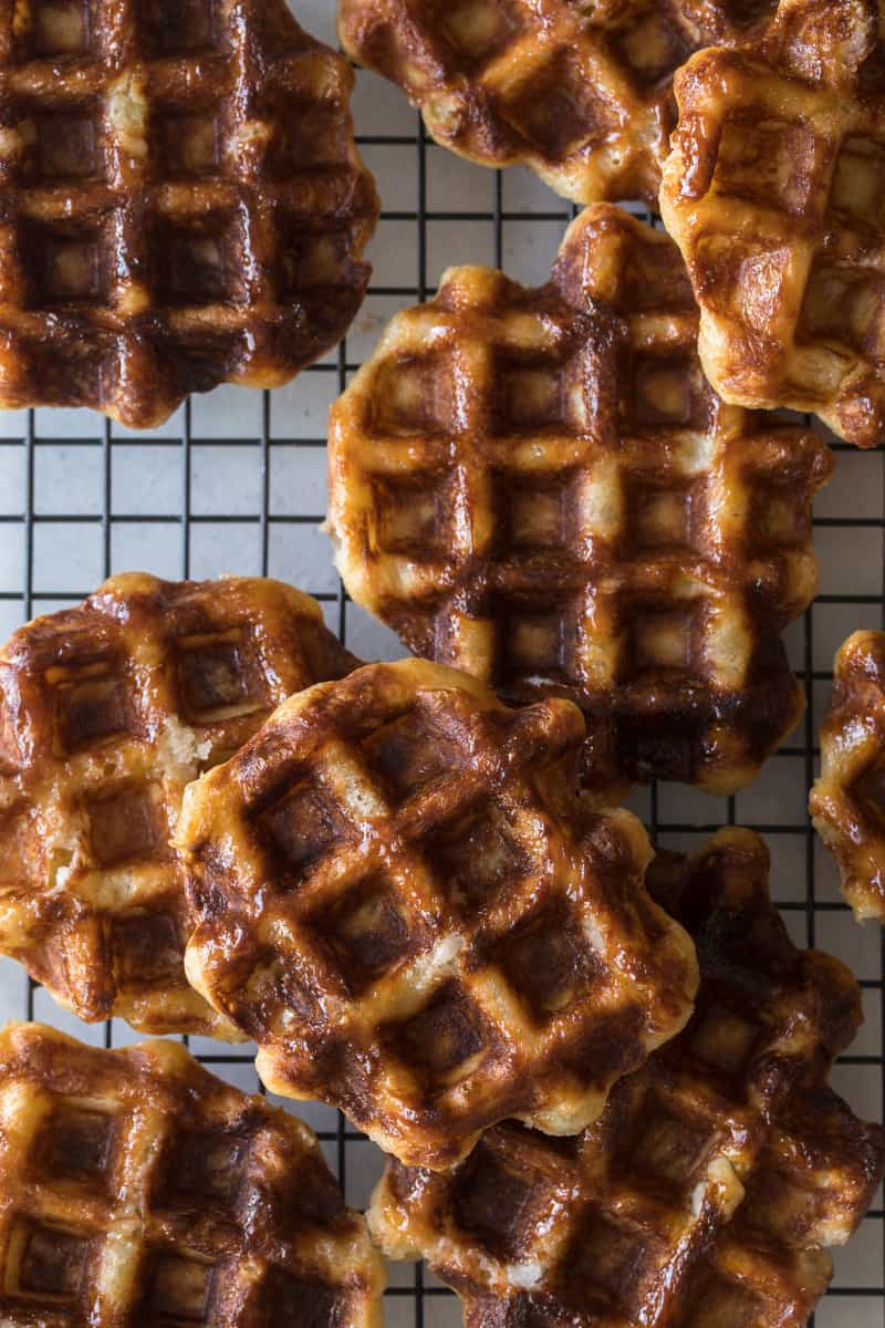 Close up of liege waffles on a cooling rack.