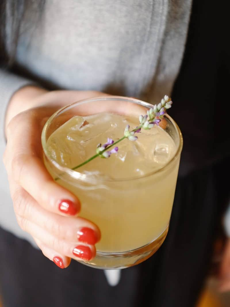 A close up of a lavender bees knees cocktail.