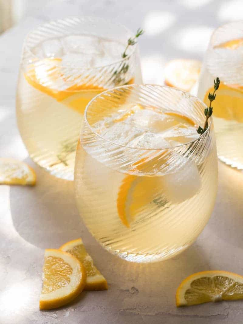 A close up of meyer lemon and thyme bees knees cocktails.