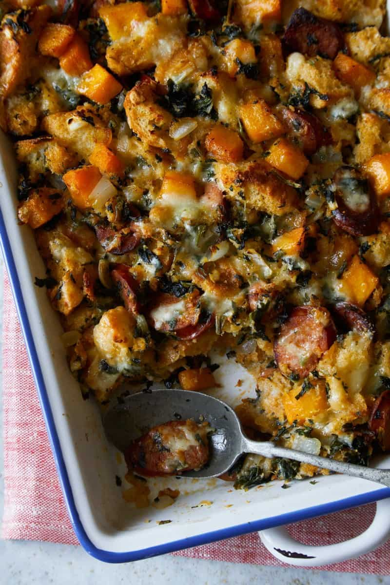 A close up of butternut squash sage stuffing with a spoon.