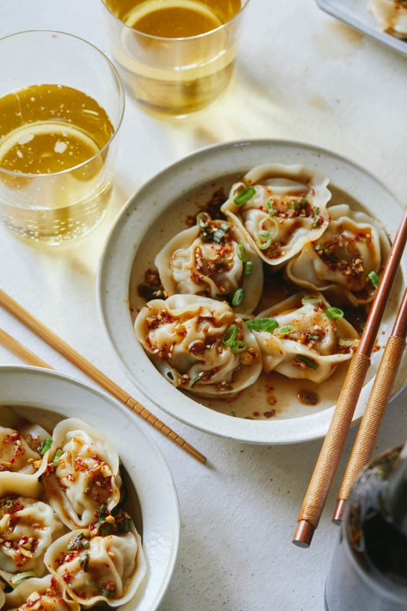 Bowls of pork and shrimp dumplings with chopsticks.