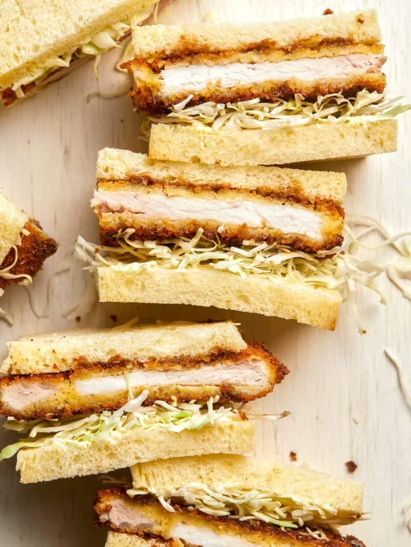 A close up of pork katsu sandwiches cut in half.