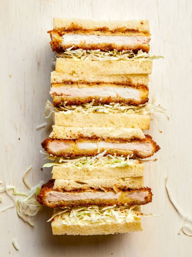 Stacked pork katsu sandwiches cut in half.