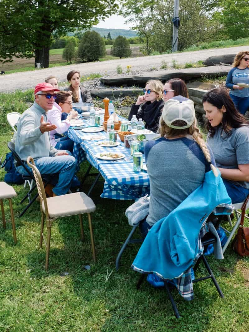 A group of people sitting at a picnic table.