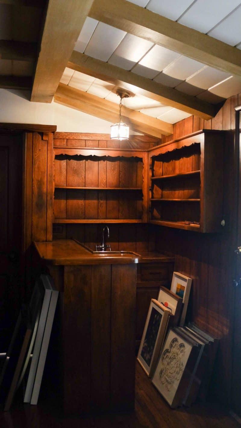 A wooden built in bar.