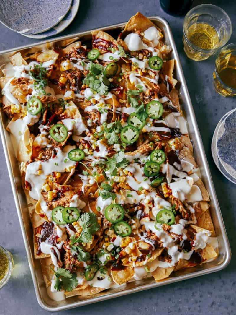 A sheet tray of chipotle chicken nachos.
