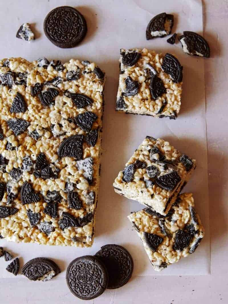 A sheet of cookies and cream Rice Krispies Treats with some squares cut off.