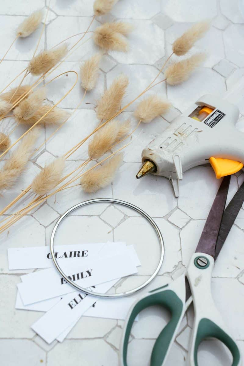 Supplies and tools needed to make mini wreath place cards.