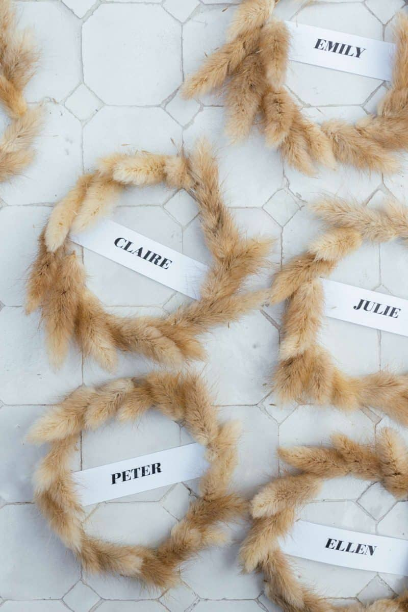 Dried bunny tail wreaths with paper labels.