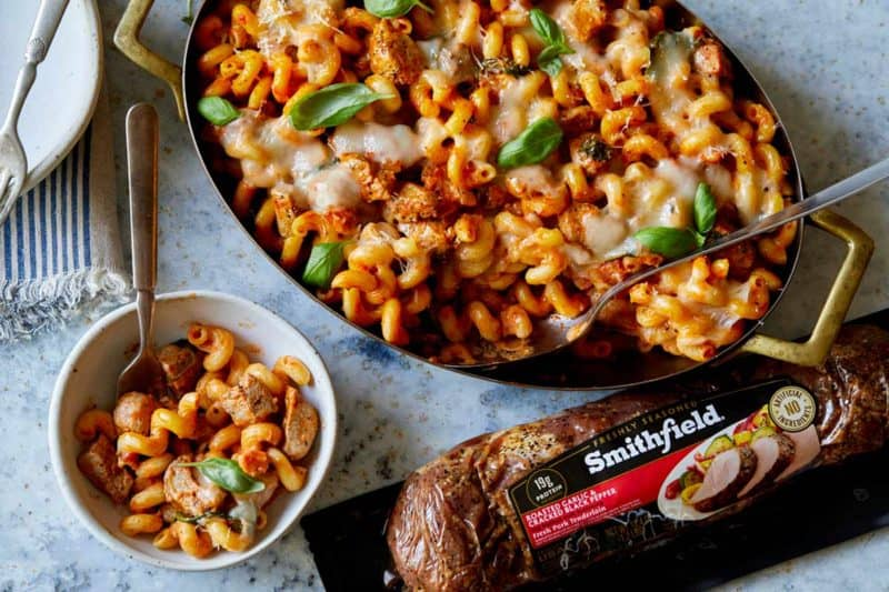 Pan of creamy baked pork pasta with Smithfield pork package.