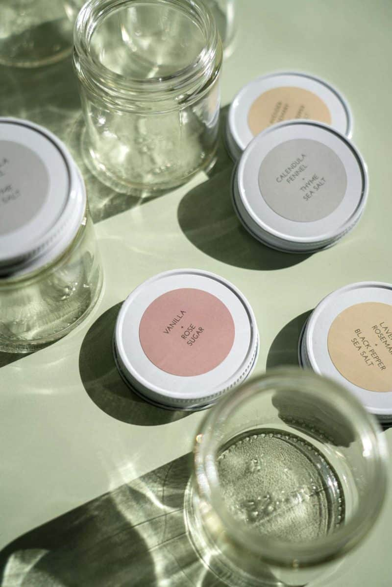 A close up of jars and lids with printed labels.
