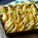 Close up on Ricotta and Spinach Stuffed shells after they are baked.