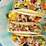 Grilled Zucchini tacos close up on a plate.