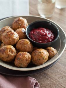 Perfect holiday recipe for Herbed Turkey Meatballs with a Barbeque Cranberry Sauce.