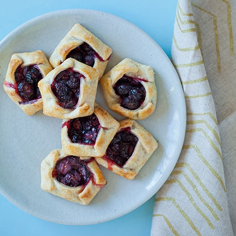 Blueberry Galette recipe on a plate with a napkin next to it.