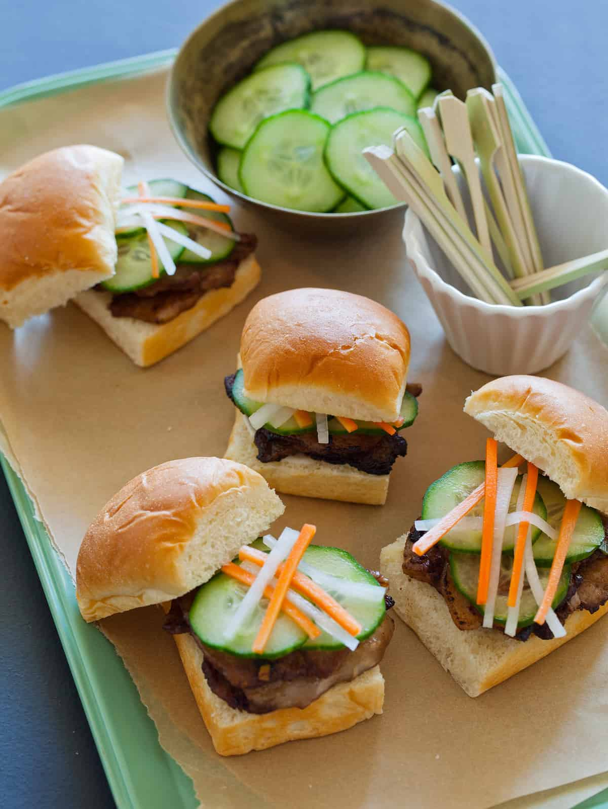 Pork Belly Sliders with pickled daikon and carrots.