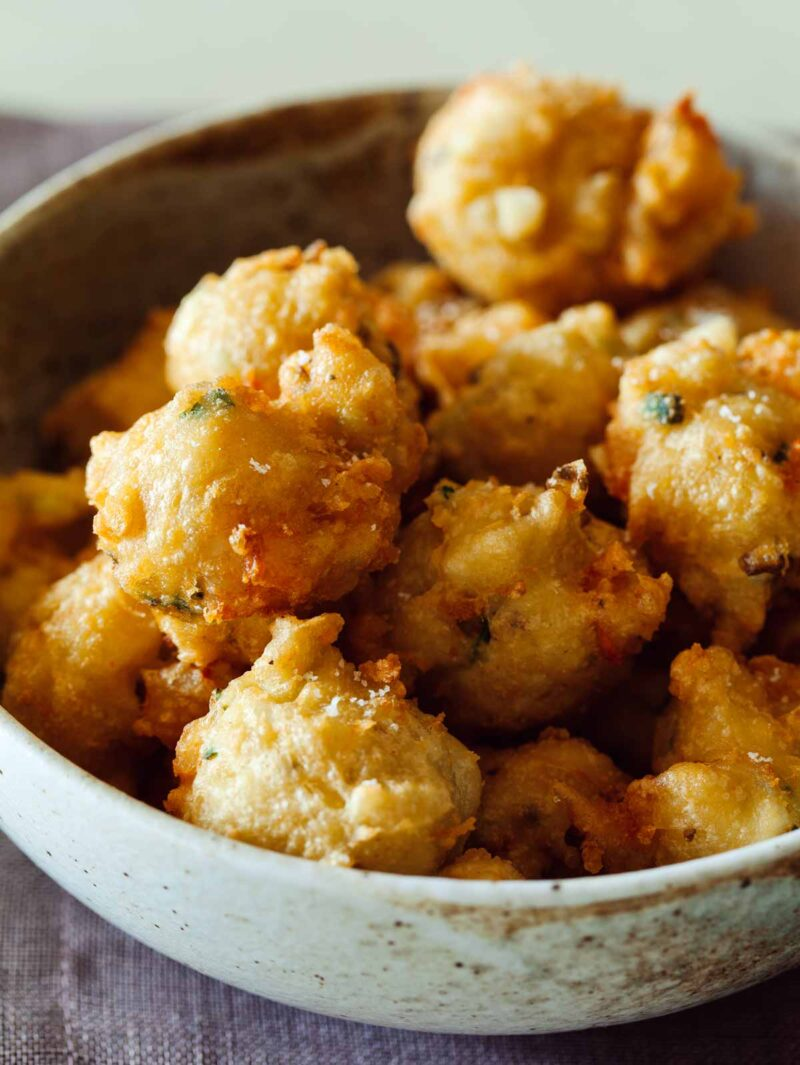 A close up of shrimp fritters in a bowl.