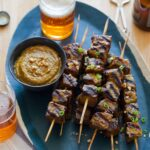Beef Satay recipe with a peanut dipping sauce.