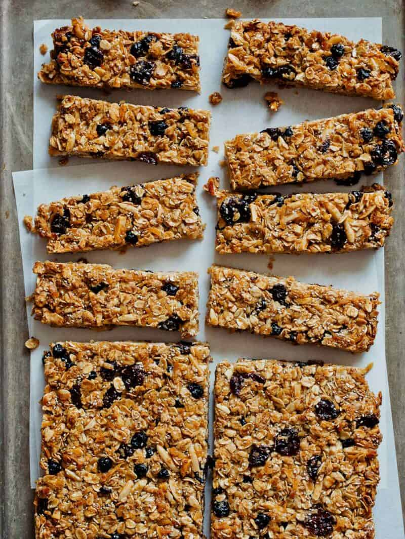 A tray of homemade granola bars with coconut and dried cherries and blueberries.