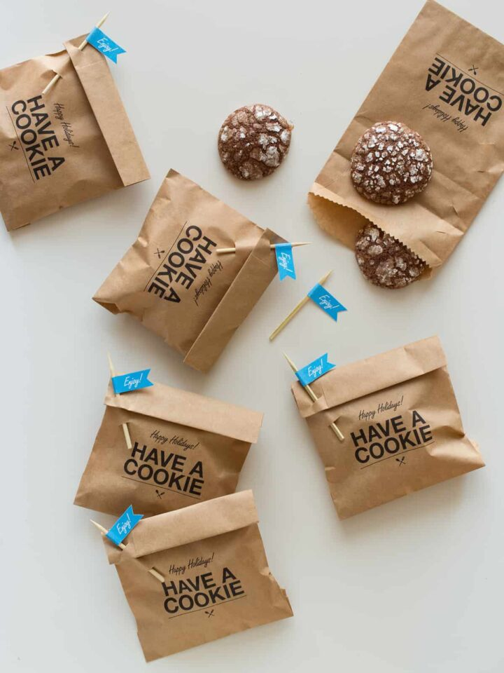 """Cookie gift bags with """"enjoy"""" labeled pick closures and homemade cookies."""