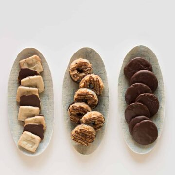 Three oval platters of a variety of homemade girl scout cookies.