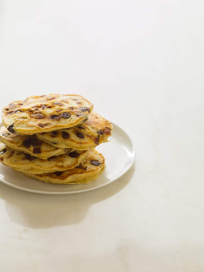 A recipe for Chocolate Chip Bacon and Orange Kissed Pancakes.