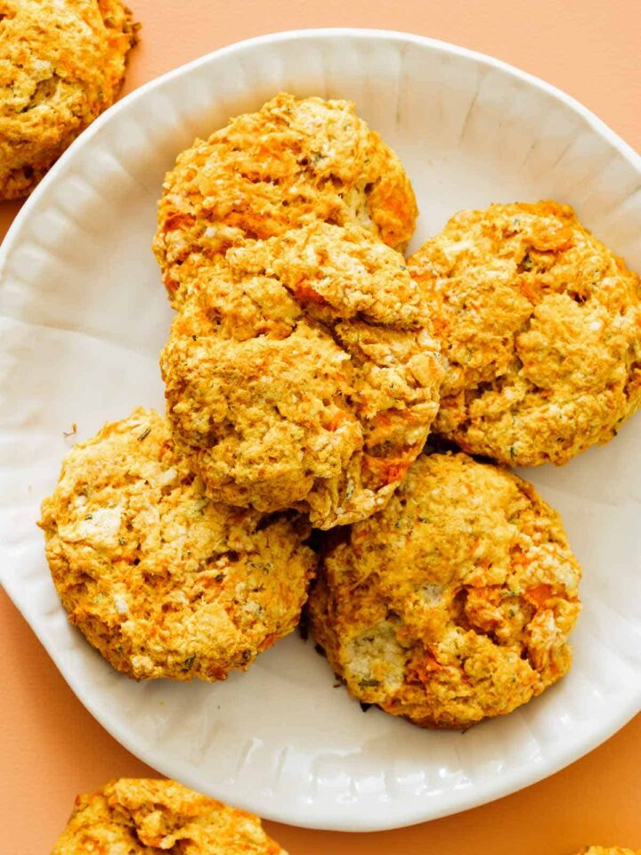 A close up of a plate of sweet potato and rosemary biscuits.