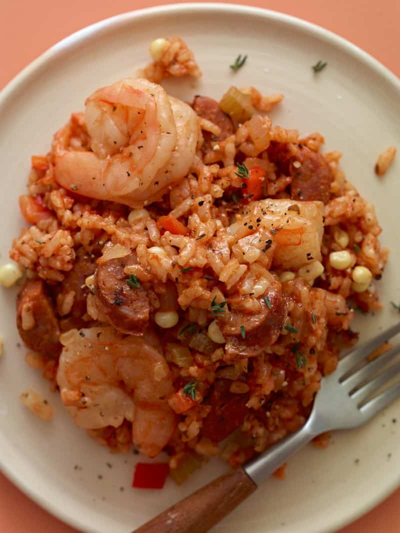 Shrimp and Andouille Jambalaya on a plate for a fork next to it.
