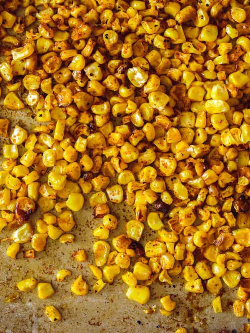 A close up of roasted corn for elote fritters.