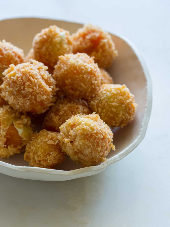 A close up of a bowl of peppadew poppers.
