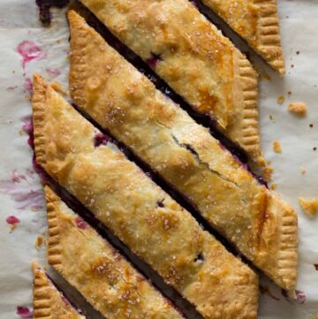 A bias cut blueberry slab pie.