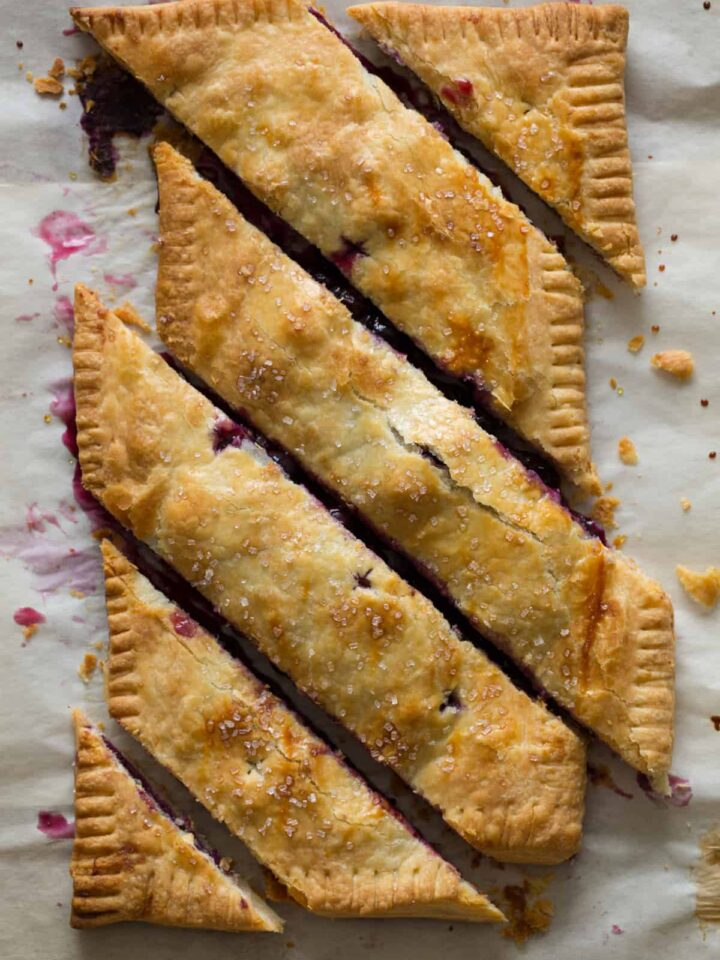 A bias cut blueberry slab pie.