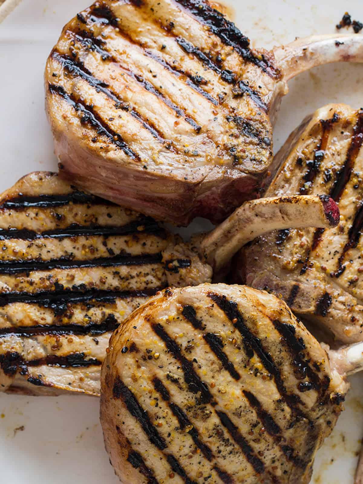A close up of mustard crusted pork chops.